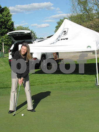 Donna McAnally demonstrates her putting style at the putting green at the Ladies Event.