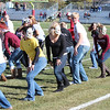 """Fans who got to the Chadron State College homecoming football game early were treated to a flash mob organized by students. Appropriate to the """"Zombie Apocalypse"""" theme, the students danced to the CSC Show Band's rendition of Michael Jackson's """"Thriller."""" (Photo by Brooke Schumacher)"""