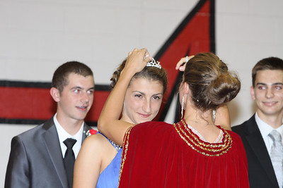 Lutheran West 2014 Homecoming Queen Katie Snable being crowned by 2013 Homecoming Queen Emily Mystic.