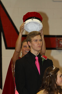 Lutheran West 2014 Homecoming King Carter Deblock being crowned by 2013 Homecoming Queen Emily Mystic.