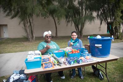 Diamond Jackson (left) and Miranda Garcia awarding prizes to the winners of the homecoming picnic games.