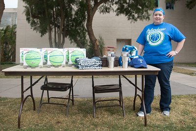 Sarah Judy standing next to the prizes for the homecoming picnic.