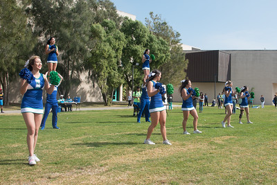 Cheerleaders showing off their school spirit at the homecoming picnic.