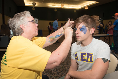 Richard A. Schreiber participates in the festivities during the Tip Off Picnic by having his face painted.