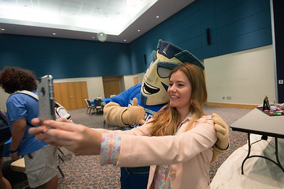 Andrea Amaya takes a selfie with Izzy.
