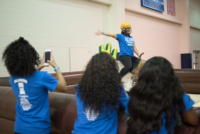 A student takes on the challenge of the mechanical bull ride during Friday Fiesta.