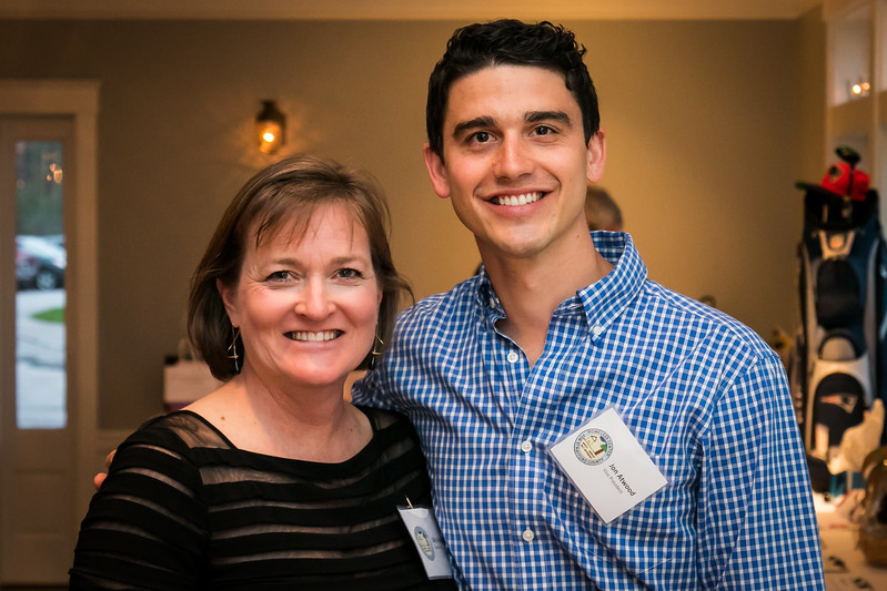 Executive Director Sally Struble, left, and Vice President Jon Atwood, right, enjoy a night of fundraising at the Homeless Center for Strafford County Spring Fling fundraiser event held at The Oaks in Somersworth Friday. [Scott Patterson/Fosters.com]