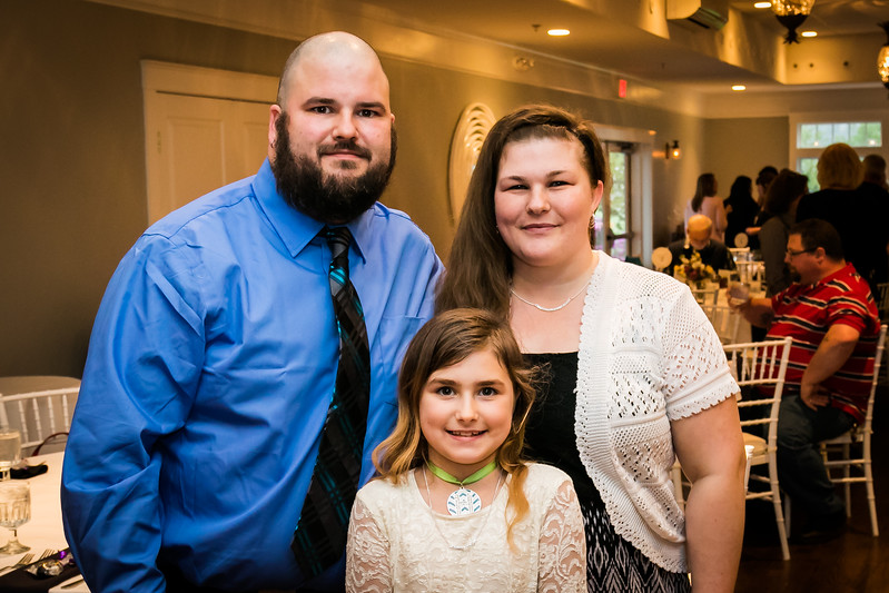 Guest speaker Tristan Jabre, left, along with his wife Ryann and daughter Hayvin, 8, attend the Homeless Center for Strafford County Spring Fling fundraiser event held at The Oaks in Somersworth Friday. [Scott Patterson/Fosters.com]