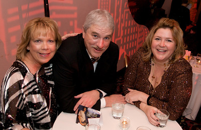 Nancy and Tom Cartwright with Kim Braken at The Cincinnati Hilton Netherland Plaza for the Hometown Hollywood Oscar party