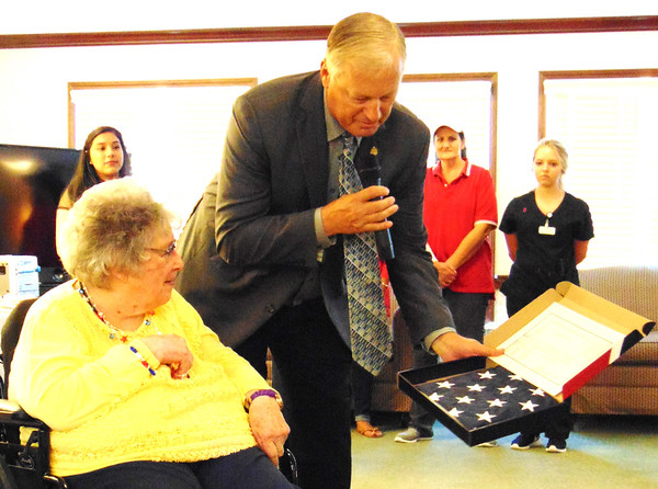 """Debbie Blank   The Herald-Tribune<br /> """"Thank you for your service to this great nation,"""" state Rep. Randy Frye (right) told Mary Gargano. He presented her with an American flag that flew over the Indiana Statehouse Dec. 8, 2016, with a document signed by then governor and now Vice President Mike Pence."""