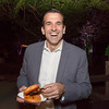 Mayor Sam Licciardo enjoying a cheeseburger donut