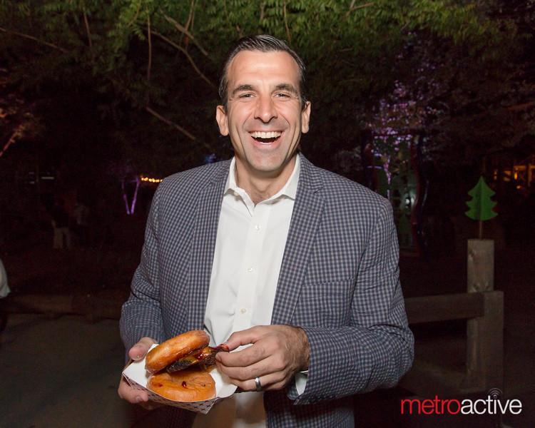 Mayor Sam Licciardo enjoying a cheeseburger donut