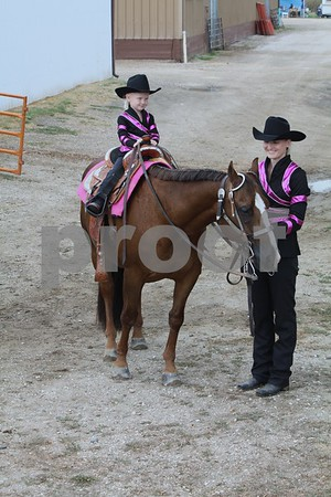 Raegan Wagner and daughter Reese riding Sugar.