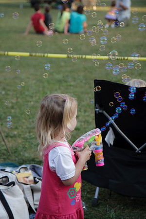 girl with bubble blower gun