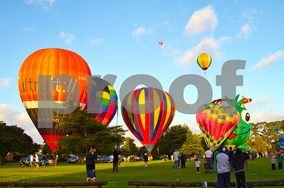 People watch as hor air balloons take off.  Hamilton, Waikato, New Zealand