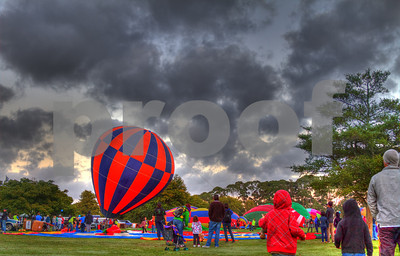 People watch as hot air balloons prepare to take off, Hamilton, Waikato, New Zealand
