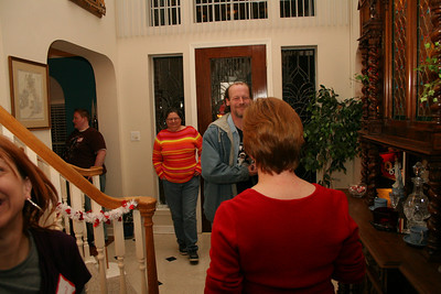 Linda greeting Tony and Beverly at the front door.