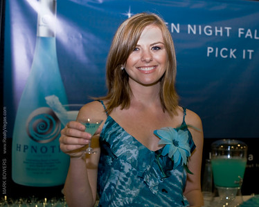 High quality photograph at Hpnotiq event Las Vegas Girls's Day Out South Point Casino. Hpnotiq liqueur made with vodka, cognac, and tropical flavors. colored blue and about 34 proof was created by Raphael Yakoby in 2001 and is now owned and distributed by Heaven Hill Distilleries in Kentucky, www.heaven-hill.com  Photograph by Las Vegas photographer Mark Bowers.