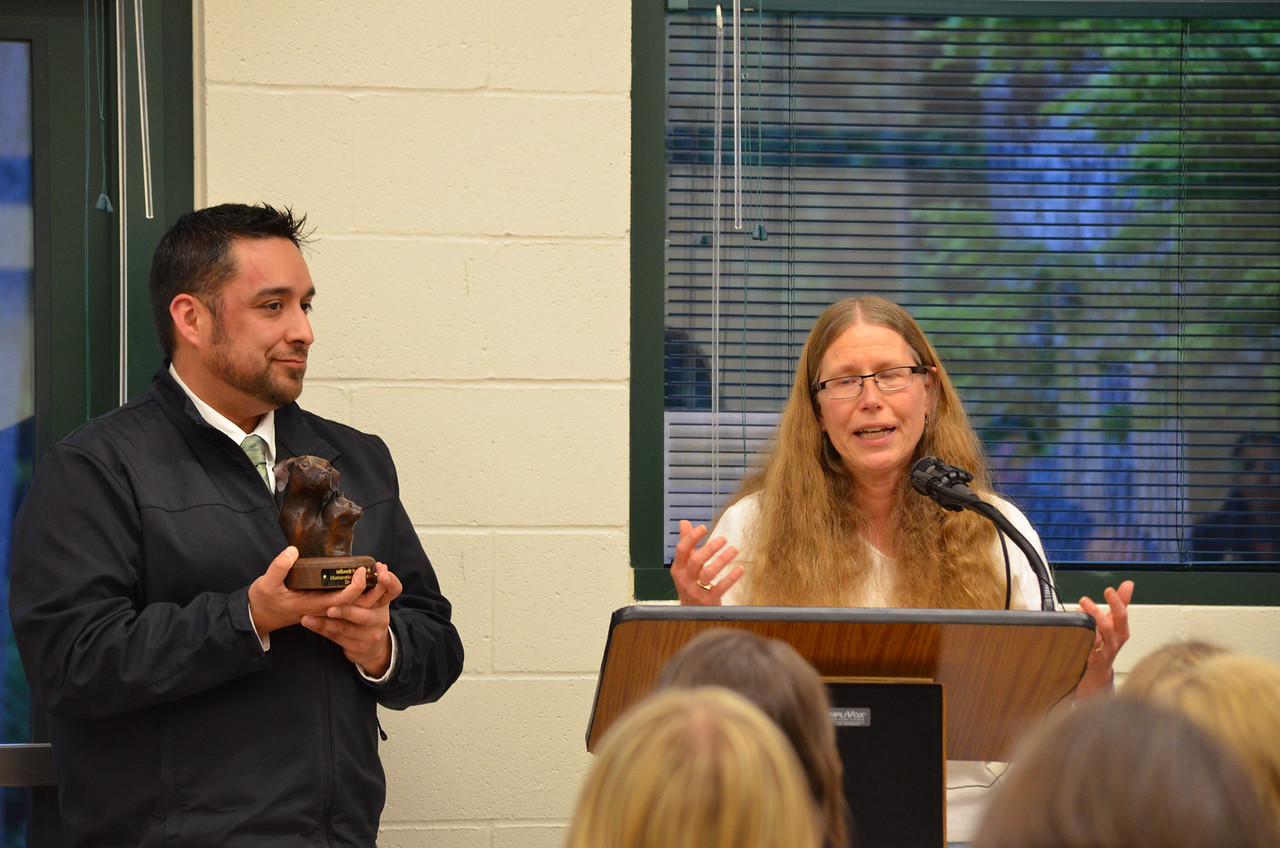 Denise Smith accepts the Humaneitarian Award from 2013 Humaneitarian Juan Lopez of Willamette Valley Animal Hospital