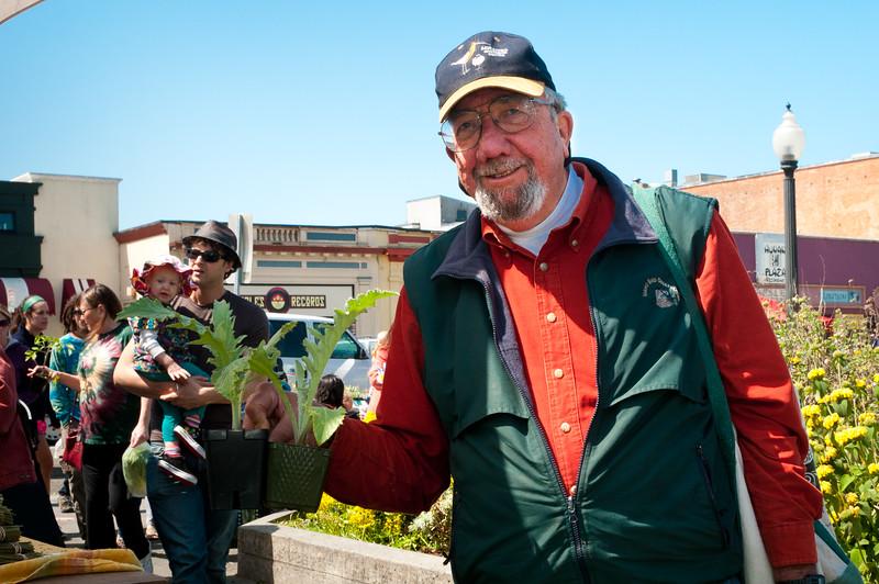 C.J. with his artichokes--looking forward to mayonnaise, Arcata Farmers Market, May 5, 2012. [Farmers Market 2012-05 004 Arcata-CA-USA]
