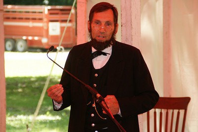 Tom Leahy portraying Abraham Lincoln