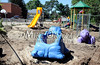 8/30/2011 Mike Orazzi | Staff<br /> Damage to the playground at the Clara T. O'Connell School after flood water from the Pequabuck River rose flooding the school after heavy rain from Hurricane Irene.