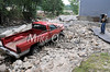 9/1/2011 Mike Orazzi | Staff<br /> Jim Murdock stands among some of the damage to his property at Vintage Boat Restorations in Bristol after Pequabuck River flooding caused by Hurricane Irene's heavy rain in many parts of Central Connecticut. <br /> ** for a Steve story **