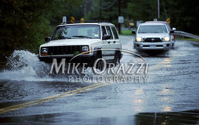 8/28/2011 Mike Orazzi | Staff A Jeep Cherokee leads the ways as motorists travel west on Route 72 where it intersects with Poland Brook in Terryville after Hurricane Irene passed through Central Connecticut Saturday into Sunday.