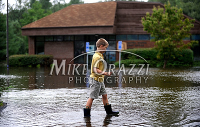 8/28/2011 Mike Orazzi | Staff Tyler Mendella at the flooded Plymouth post office in the Terryville section of town after Hurricane Irene passed through Central Connecticut Saturday into Sunday.