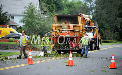 8/28/2011 Mike Orazzi | Staff Work crews removed a downed tree on Emmett Street in Bristol  after Hurricane Irene passed through Central Connecticut Saturday into Sunday.