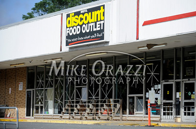 8/28/2011 Mike Orazzi | Staff Tape on the windows of the Bristol Discount Foods Grocer store in downtown Bristol after Hurricane Irene passed through Central Connecticut Saturday into Sunday.