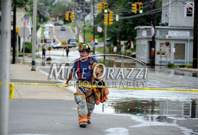 8/28/2011 Mike Orazzi | Staff A Bristol firefighter in Forestville while police and fire crews search for a missing Kayaker after Hurricane Irene passed through Central Connecticut Saturday into Sunday.  Two kayakers where spotted in the river, one was pulled out and the search is continuing for the other one.