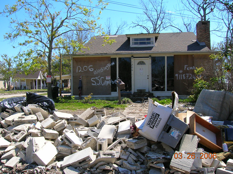 1206 Washington Ave. with a pile of what looks like foundation or concrete block wall debris.