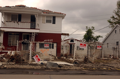 "Destroyed home in the 9th Ward of New Orleans along St. Claude with signs that say ""No Bulldozing, Save Our Neighborhood."""