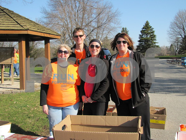 Working at the HyVee 5K were Cari Wiemann, Steven Linden, Lindsey Kavanaugh, and Jen Fitzgerald.