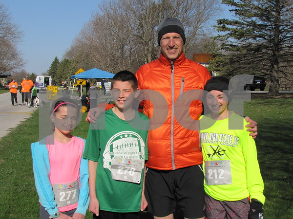 The family of Hannah, Isaac, Mike, and Abby Landwehr participated in the HyVee 5K for JDRF.