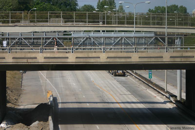 A lone pedestrian crossing the 4th Street bridge