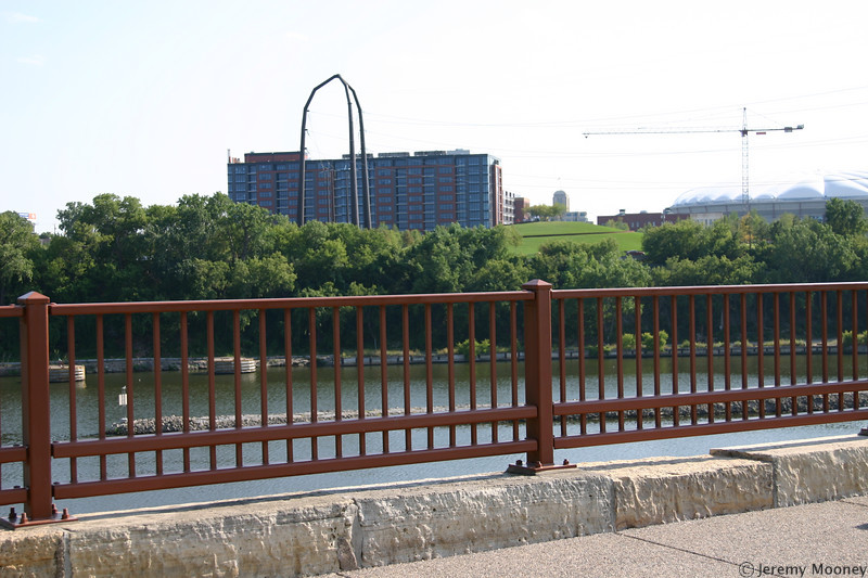 The mound at Gold Metal Park, where many memorials have been left, as viewed from the Stone Arch Bridge