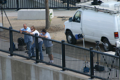 It appears the TV station workers wait there at the railing most of the day.