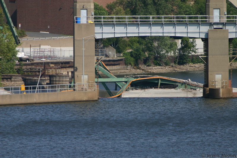 The first visible part of the center span.  The beam on the far left is part of the bridge visible in prior photos.