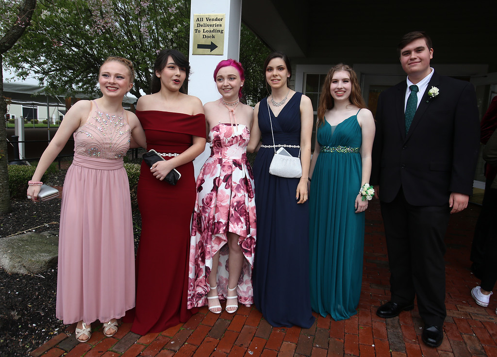 . Innovation Academy Charter School prom.  From left, Hailey Mills of Tewksbury, Lily LeDuc of Lowell, Emily Green of Lowell, Sarah Wagner of Chelmsford, Hannah Goldthwait of Dracut, and Dylan Urban of Chelmsford. (SUN/Julia Malakie)