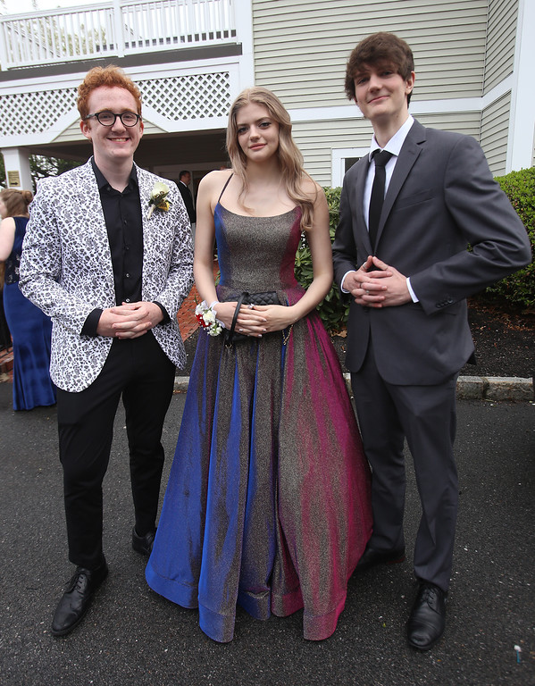. Innovation Academy Charter School prom. From left, Jacob Babcock of Dracut, Tess Colella of Chelmsford and Tom Bojsen of Billerica. (SUN/Julia Malakie)