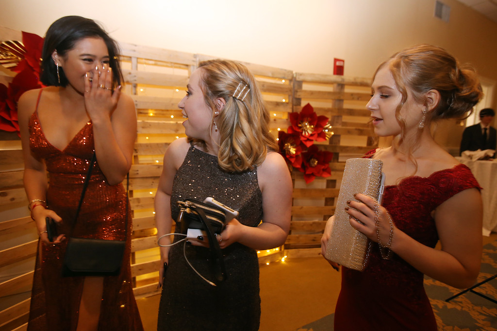 . Innovation Academy Charter School prom. From left, Evelyn Sourn and Katie White, both of Tyngsboro, and Lauren Pichette of Tewksbury. (SUN/Julia Malakie)