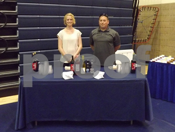 Kristan Giddings and JJ Lane working at the drink table.