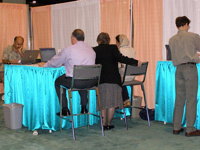 Carol Bieschke assists an employer with the careers online system at the FASEB Career Center/MARC Program Resource Center - IMMUNOLOGY 2007 meeting in South Beach, FL.