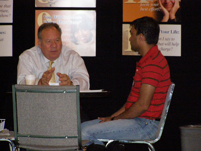 Dr. Cliff Mintz providing career counseling and resume critique services to a job seeker at the FASEB Career Center/MARC Program Resource Center - IMMUNOLOGY 2007 meeting in South Beach, FL.
