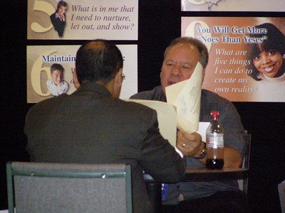 Dr. Cliff Mintz providing resume critique services to a job seeker at the FASEB Career Center/MARC Program Resource Center - IMMUNOLOGY 2007 meeting in South Beach, FL.