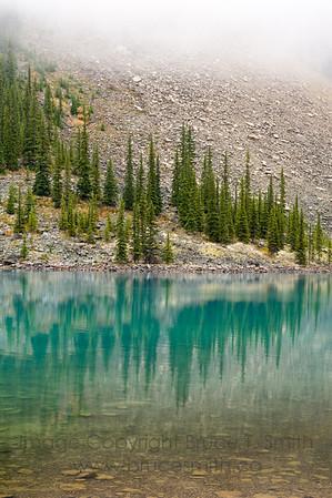 Foggy reflection of Moraine Lake, Banff National Park
