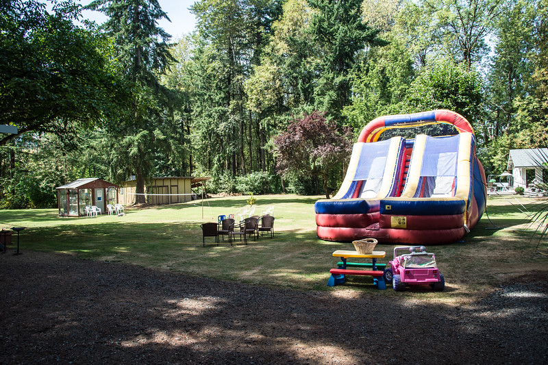 Setup before the party reflects the actual size of the bounce house and slide compared to our greenhouse.  Yikes!   :-)