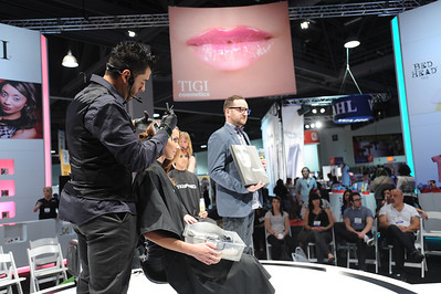 TIGI stylist demonstrating the latest in hair cutting techniques